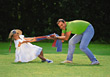 Tugging Father and Dauther Playing Outdoors stock photo