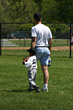 Father and son at baseball field stock photography