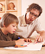 Father and Son Doing Homework stock photography