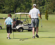 Father and Son Golfing stock image