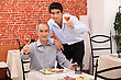 Outing Father And Son Having Dinner Together stock photo