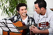 Guidance Father And Son With Acoustic Guitar stock image
