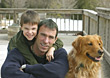 Father and Son with Golden Retriever stock photo
