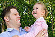 Father And Daughter Having Fun In The Park