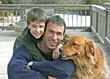 Father and son outside with the family dog stock photography
