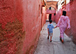 Father and Son Walking In Old Arab Village stock photography