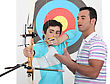 Father Teaching His Son How To Shoot A Bow stock photo