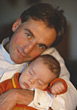 Father with Sleeping Baby stock photo