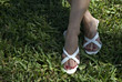 Feet Wearing Sandals In Grass