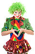 Female Clown Makes The Heart With His Hands stock photography