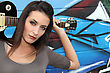 Female Guitarist Standing In Front Of A Graffitied Wall stock photography