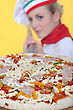 Pizza Female Pizza Cook Putting A Pizza In An Oven stock photography