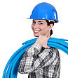 Female Plumber Carrying Pipes stock photography