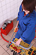 Female Plumber Sawing Pipe stock image