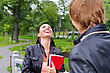 Female Student Chatting With Friend Outdoors stock image