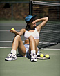 Female Tennis Player Resting stock photo