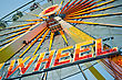 "Ferris Wheel With Glowing Letters ""WHEEL"" On It stock photography"