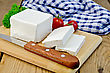 Checkered Feta Cheese, Knife, Parsley, Tomatoes, Napkin On A Wooden Board stock photography