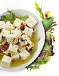 Feta Cheese With Olive Oil , Herbs And Fresh Salad Leaves stock photo