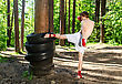 Boxer Fighter Kicking Rubber Wheels With The Leg stock image