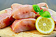 Fillet Of Red Grouper, Lemon, Basil On A Round Wooden Board stock photography
