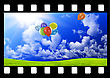 Filmstrip With Color Balloons In The Sky Over Glade stock image