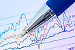 Financial Graphs Analysis With Pen And Printed Chart stock photo