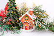 Fir Tree Candle And Toy House On Gray Background stock photo