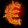 Fire Euro Sign On A Black Background stock photography