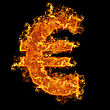 Conceptual Images Fire Euro Sign On A Black Background stock photo
