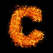 Glow Fire Letter C On A Black Background stock image