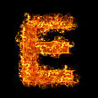 Blazing Fire Letter E On A Black Background stock photography