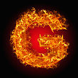 Blazing Fire Letter G On A Black Background stock photo