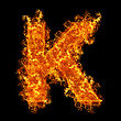 Fire Letter K On A Black Background stock photo