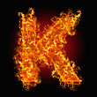 Flammable Fire Letter K On A Black Background stock image