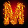 Fire Letter M On A Black Background stock image