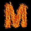 Fire Letter M On A Black Background stock photo