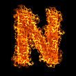 Fire Letter N On A Black Background stock photography