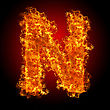 Fire Letter N On A Black Background stock image