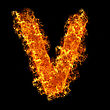 Fire Letter V On A Black Background stock photography