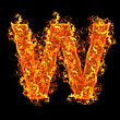 Fire Letter W On A Black Background stock image
