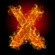 Fire Letter X On A Black Background stock photo