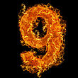 Fire Number 9 On A Black Background stock photo