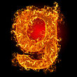 Fire Small Letter G On A Black Background stock photo