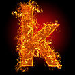 Ignite Fire Small Letter K On A Black Background stock photo
