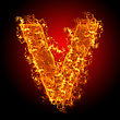 Fire Small Letter V On A Black Background stock image