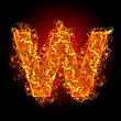 Fire Small Letter W On A Black Background stock photography