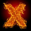 Fire Small Letter X On A Black Background stock image