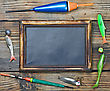 Fishing Gear And Blackboard On Wooden Background stock image