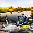 Fishing Tackle And Caught Fish On The Table At Sunset stock photo